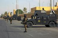 Iraqi counter-terrorism forces stand guard in front of the US embassy in the capital Baghdad on January 2, 2020