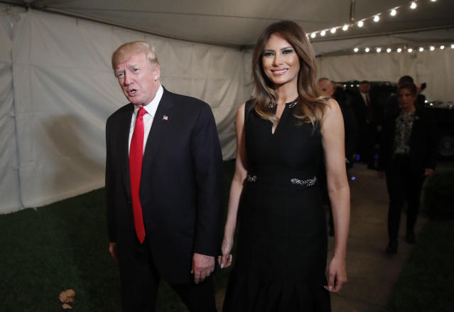 <p>President Donald Trump and first lady Melania arrive for Christmas Eve service at the Church of Bethesda-by-the-Sea in West Palm Beach, Fla., Sunday, Dec. 24, 2017. (AP Photo/Carolyn Kaster) </p>