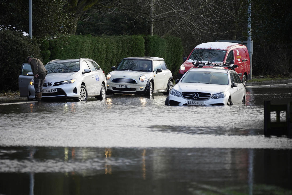LYMM, UNITED KINGDOM - JANUARY 20: Cars are abandoned in floodwater on January 20, 2021 in Lymm, Cheshire. Danger to life flood warnings are given along the River Mersey in East Didsbury, West Didsbury and Northenden as Storm Christoph moves in on the UK.  (Photo by Christopher Furlong/Getty Images)