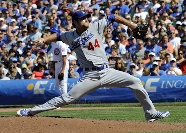Los Angeles pitcher Chris Whitlow throws a pitch in the sixth inning of a baseball game between the Chicago Cubs and the Los Angeles Dodgers Sunday Aug. 4, 2013 in Chicago, Ill. (AP Photo/Joe Raymond)