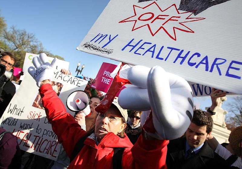 Polling has consistently found the public to be narrowly divided over Obamacare, with some such as these demonstrators, shown at March 2012 protest, rejecting the program (AFP Photo/Alex Wong)