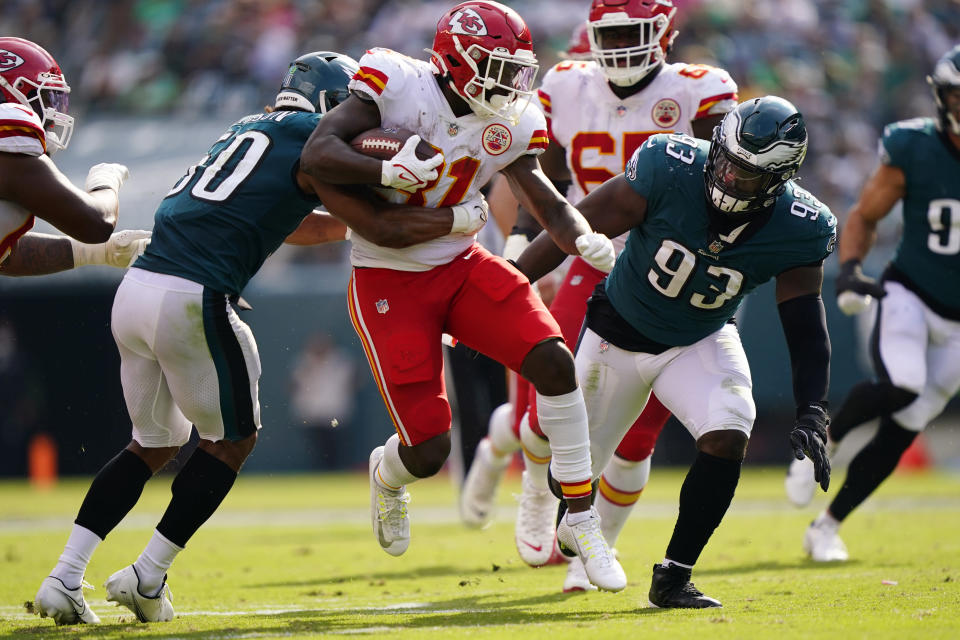 Kansas City Chiefs running back Darrel Williams (31) runs with the ball in front of Philadelphia Eagles defensive tackle Milton Williams (93) and Philadelphia Eagles linebacker Eric Wilson (50) during the second half of an NFL football game Sunday, Oct. 3, 2021, in Philadelphia. (AP Photo/Matt Rourke)