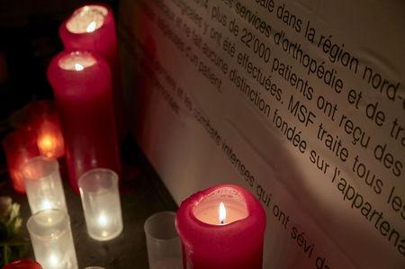 Candles are pictured outside the Medecins Sans Frontieres (MSF) headquarters in Geneva, Switzerland October 7, 2015. REUTERS/Denis Balibouse