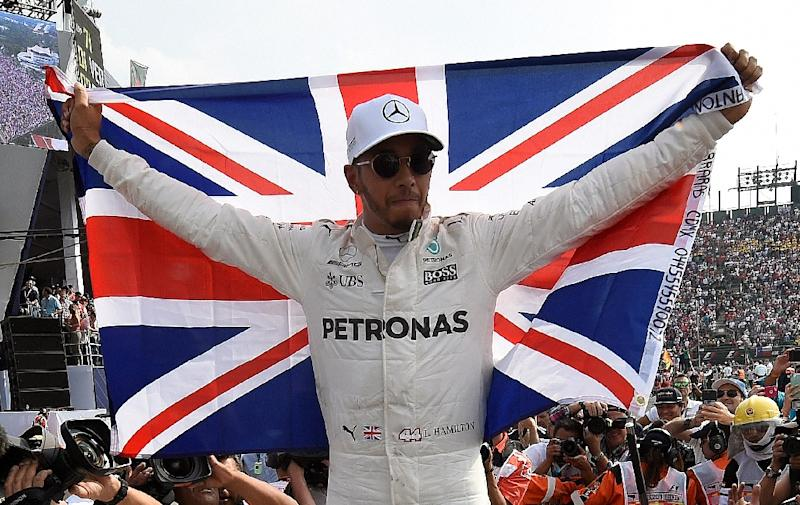 Lewis Hamilton reportedly avoided paying taxes on his private jet (AFP Photo/Alfredo ESTRELLA)