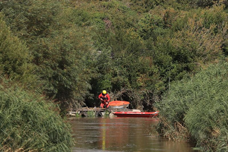 A member of Kent Search and Rescue searches a section of the River Stour (PA)