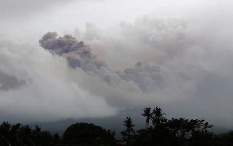 <span>Dark pyroclastic ash rises into the sky</span> <span>Credit: APTN </span>