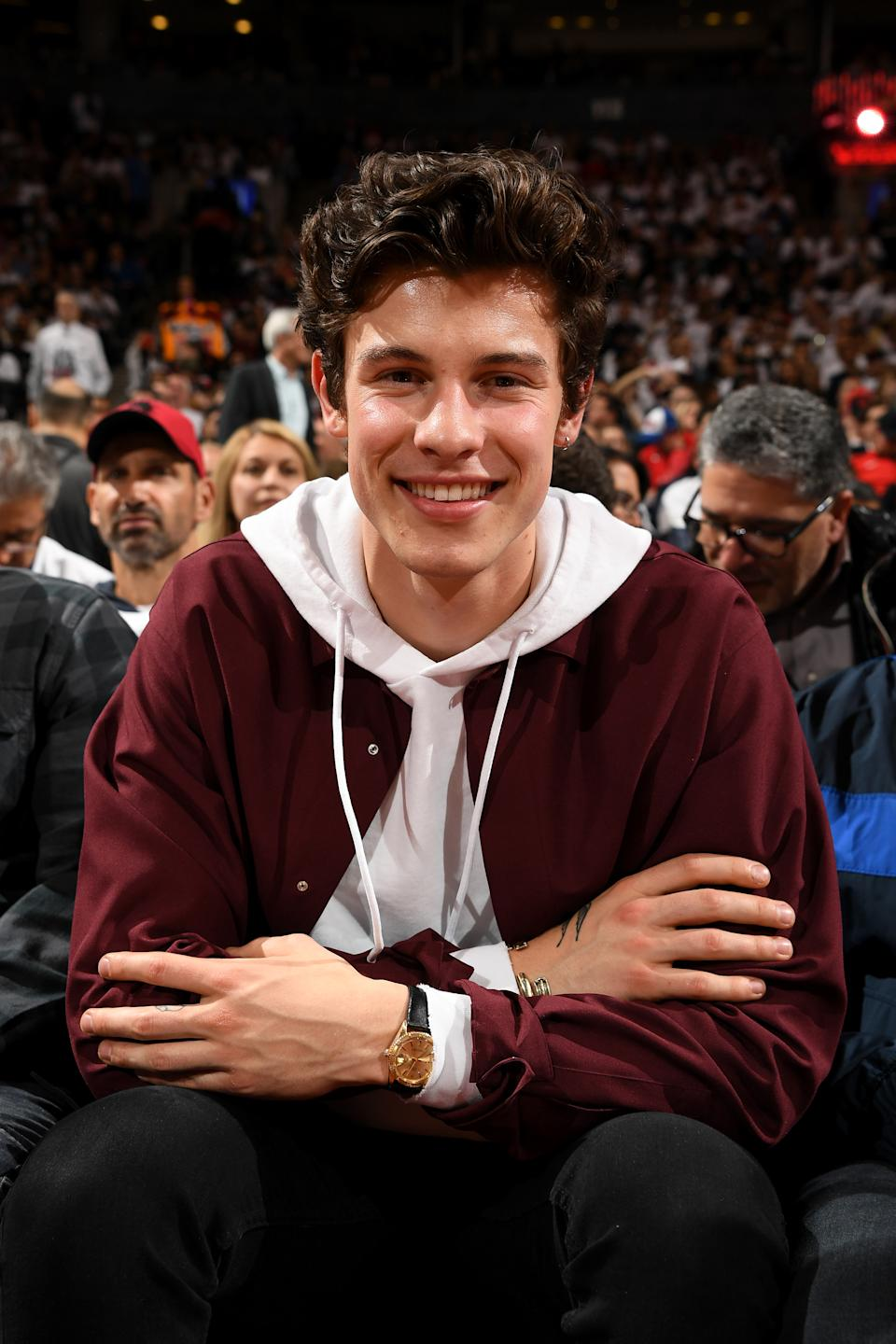 Singer, Shawn Mendes smiles at the game between the Philadelphia 76ers and Toronto Raptors during Game One of the Eastern Conference Semi-Finals of the 2019 NBA Playoffs on April 27, 2019 at the Scotiabank Arena in Toronto, Ontario, Canada. (Photo by Ron Turenne/NBAE via Getty Images)