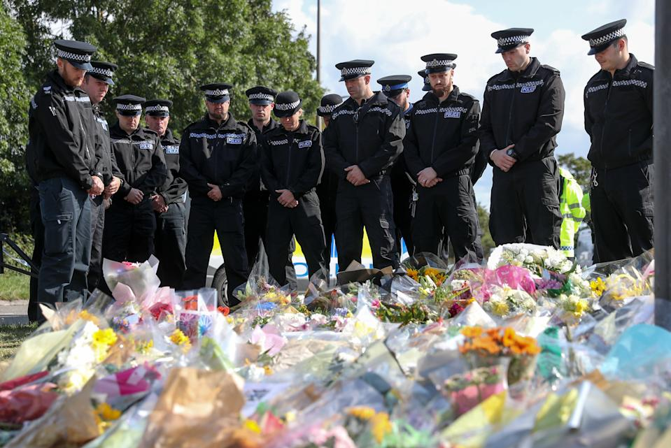 Police officers gather to pay their respects at the scene near Ufton Lane, Sulhamstead, Berkshire, where Thames Valley Police officer Pc Andrew Harper, 28, died on Thursday near the village of Sulhamstead in Berkshire.
