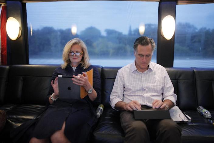 "FILE- In this Jan. 29, 2012, file photo, Republican presidential candidate, former Massachusetts Gov. Mitt Romney, and his wife Ann work on their iPads on their campaign bus as it travels to Hialeah, Fla. The spotlight on Ann Romney is getting brighter. Two out of three voters still don't know the wife of the presumptive Republican presidential nominee. But her profile is growing as Mitt Romney moves into the general election against President Barack Obama. She was a stay-at-home mother of five boys. She bakes cookies. And, at 63, she has 16 grandchildren who call her ""Mamie."" But don't be fooled: Republicans and Democrats alike see Ann Romney as an effective political weapon. (AP Photo/Charles Dharapak, File)"