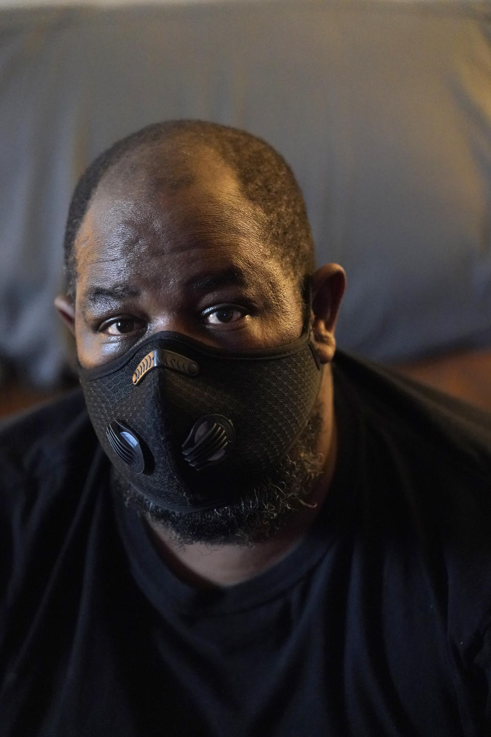 Freddie Davis poses for a photo in his apartment, Monday, June 21, 2021, in Miami. With the federal eviction moratorium extended through July, the focus has turned to getting rental assistance out to millions of tenants. Davis, a truck driver who lost his job during the pandemic and saw his rent increase from $875 to $1,400-a-month. He is $7,000 behind on rent and fears his monthly $1,038 disability check after he lost a leg to diabetes won't be enough to find another place. He applied for rental assistance but his landlord refused to take it. (AP Photo/Wilfredo Lee)