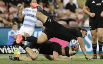 New Zealand's Caleb Clarke collides with teammate Scott Barrett as he catches the ball during the Tri-Nations rugby test between Argentina and the All Blacks in Newcastle, Australia, Saturday, Nov. 28, 2020. (AP Photo/Rick Rycroft)