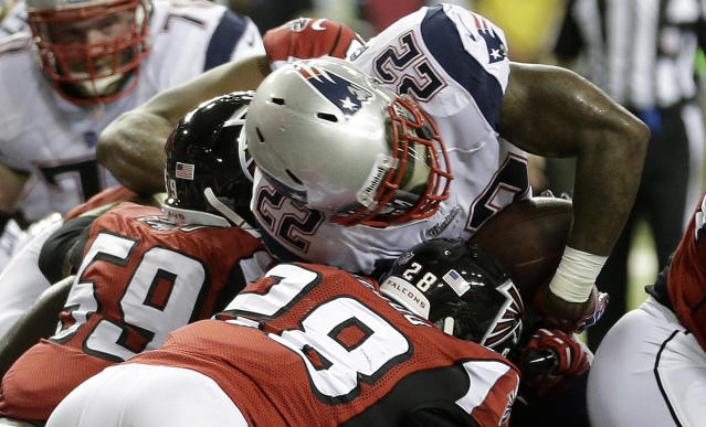 New England Patriots running back Stevan Ridley (22) works to get to the end zone against Atlanta Falcons outside linebacker Joplo Bartu (59) and Atlanta Falcons free safety Thomas DeCoud (28) during the first half of an NFL football game, Sunday, Sept. 29, 2013, in Atlanta. (AP Photo/John Bazemore)