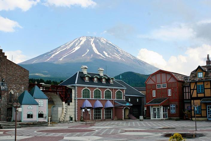 The park's town square resembles an abandoned Main Street USA at Disneyland. In the background, Japan's Mount Fuji looms. (Photo: Martin Lyle)