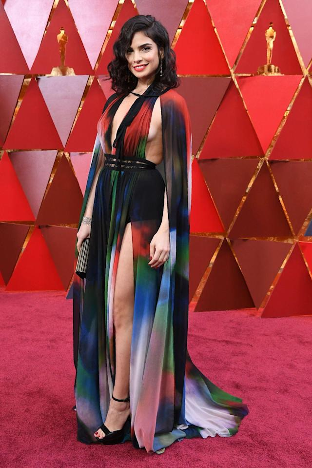 <p>Lebanese actress Rita Hayek flashed sideboob and side leg in a rainbow dress. (Photo credit should read ANGELA WEISS/AFP/Getty Images) </p>