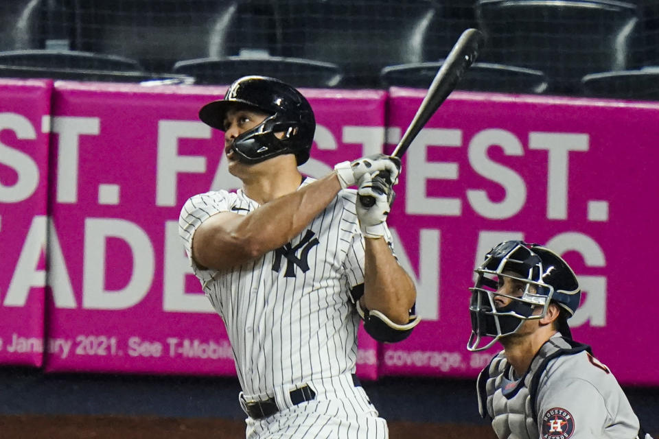 New York Yankees' Giancarlo Stanton follows through on a two-run home run during the third inning of a baseball game against the Houston Astros Wednesday, May 5, 2021, in New York. (AP Photo/Frank Franklin II)