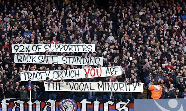 Crystal Palace fans show their support for standing at Selhurst Park in April.
