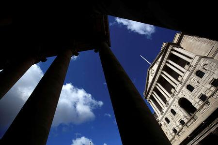 FILE PHOTO: The Bank of England is seen through the columns on the Royal Exchange building in London, Britain August 4, 2016. REUTERS/Neil Hall/File Photo