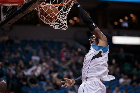 FILE PHOTO: Jan 17, 2016; Minneapolis, MN, USA; Minnesota Timberwolves forward Shabazz Muhammad (15) dunks in the fourth quarter against the Phoenix Suns at Target Center. The Minnesota Timberwolves beat the Phoenix Suns 117-87. Mandatory Credit: Brad Rempel-USA TODAY Sports / Reuters Picture Supplied by Action Images (TAGS: Sport Basketball NBA) *** Local Caption *** 2016-01-17T232520Z_281395294_NOCID_RTRMADP_3_NBA-PHOENIX-SUNS-AT-MINNESOTA-TIMBERWOLVES.JPG