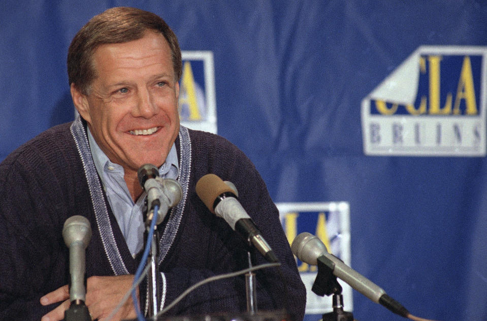 FILE - In this Dec. 11, 1995, file photo, Terry Donahue, the all-time leader in victories at UCLA and in the Pac-10, announces his resignation as head football coach, in Los Angeles. Donahue, the winningest coach in Pac-12 Conference and UCLA football history who later served as general manager of the NFLs San Francisco 49ers, died Sunday, July 4, 2021. He was 77. (AP Photo/Nick Ut, File)