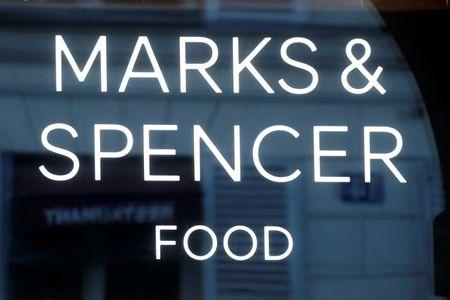 The logo of Marks & Spencer is seen in front of a store in Paris