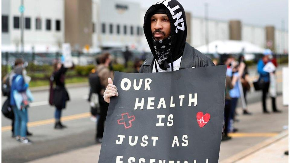 Former Amazon employee, Christian Smalls, stands with fellow demonstrators during a protest outside of an Amazon warehouse as the outbreak of the coronavirus disease (COVID-19) continues in the Staten Island borough of New York U.S., May 1, 2020.