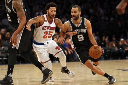 Feb 12, 2017; New York, NY, USA; San Antonio Spurs guard Tony Parker (9) drives to the basket past New York Knicks guard Derrick Rose (25) during the second half at Madison Square Garden. Mandatory Credit: Adam Hunger-USA TODAY Sports