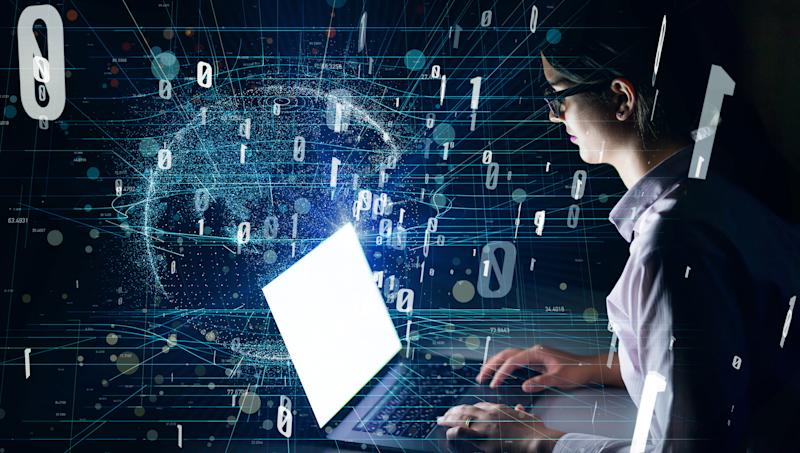 Woman using laptop and digital communication network concept.