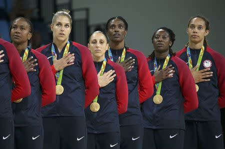 2016 Rio Olympics - Basketball - Final - Women's Gold Medal Game USA v Spain - Carioca Arena 1 - Rio de Janeiro, Brazil - 20/8/2016. Tamika Catchings (USA) of USA, Elena Delle Donne (USA) of USA, Diana Taurasi (USA) of USA, Sylvia Fowles (USA) of USA, Tina Charles (USA) of USA and Brittney Griner (USA) of USA (L to R) stand for the playing of the U.S. National Anthem during the medal presentation ceremony for the women's basketball top finishers. REUTERS/Shannon Stapleton