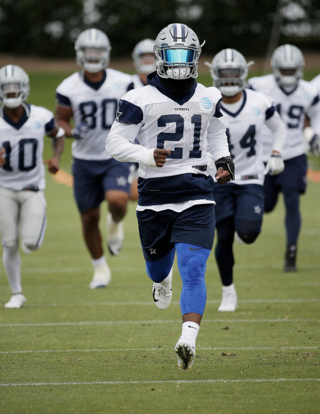 Dallas Cowboys running back Ezekiel Elliott runs during the NFL football team's training camp in Frisco, Texas, Tuesday, June 12, 2018. (AP Photo/Brandon Wade)