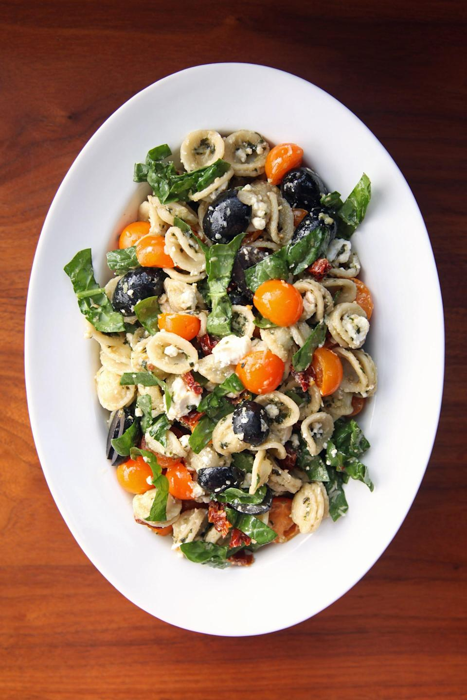 """<p>It's a fact: there's nothing better than pesto. This easy pesto pasta can be served warm or cold depending on your mood. You can add as many antipasto elements you want like olives, tangy cheese, and marinated vegetables, all of which are wonderful. Fresh veggies - spinach, tomatoes, mushrooms, and zucchini - also work well as does a protein such as tofu, grilled chicken, or salami. The options are endless! </p> <p><strong>Get the recipe:</strong> <a href=""""https://www.popsugar.com/food/Pesto-Pasta-Salad-Recipe-8810619"""" class=""""link rapid-noclick-resp"""" rel=""""nofollow noopener"""" target=""""_blank"""" data-ylk=""""slk:Mediterranean pesto pasta salad"""">Mediterranean pesto pasta salad</a></p>"""