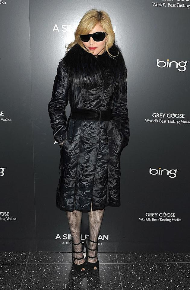 """Madonna wrapped up in an ink blue Ferragamo murmasky fur coat with fox fur collar to support her friend, designer Tom Ford, at the New York screening of his debut film, """"A Single Man."""" Stephen Lovekin/<a href=""""http://www.gettyimages.com/"""" target=""""new"""">GettyImages.com</a> - December 6, 2009"""