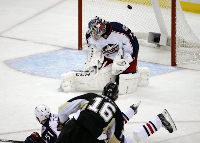 Pittsburgh Penguins' Brandon Sutter (16) puts the puck over Columbus Blue Jackets goalie Sergei Bobrovsky (72) and Fedor Tyutin (51) for a goal in the third period of a first-round NHL playoff hockey game in Pittsburgh Wednesday, April 16, 2014. The Penguins won 4-3, with Sutter's goal being the game-winner. (AP Photo/Gene J. Puskar)