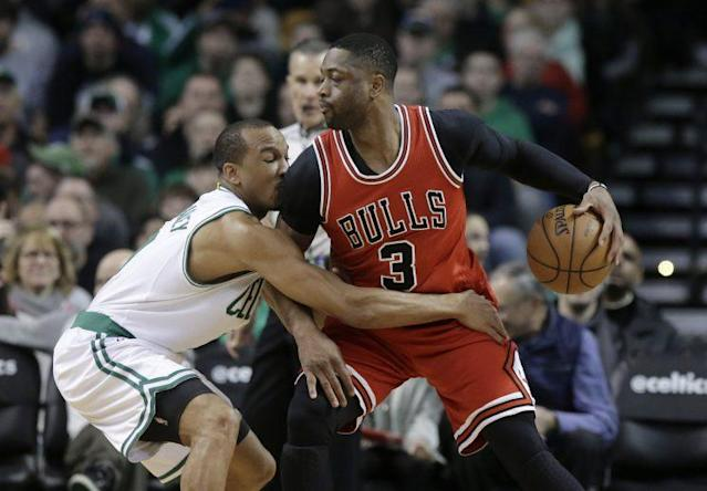 Avery Bradley and Dwyane Wade are awfully familiar with each other. (AP)