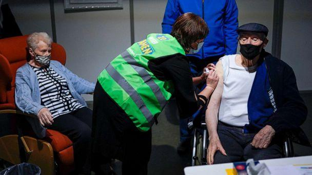 PHOTO: A man receives his first dose of the AstraZeneca COVID-19 vaccine in a mass vaccination site at the Brabanthal event center in Heverlee, Belgium, March 17, 2021. (Francisco Seco/AP)