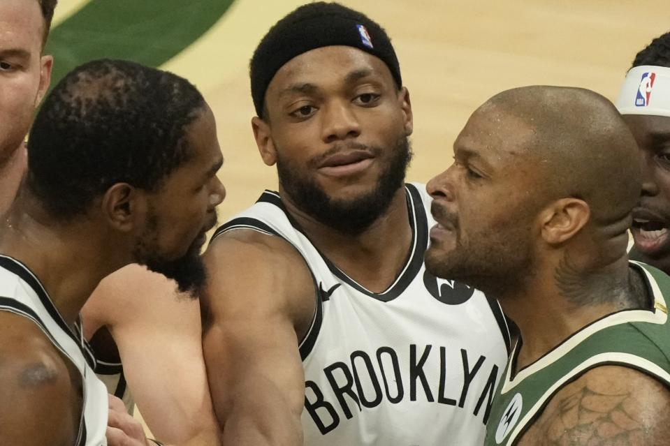 Brooklyn Nets' Bruce Brown tries to break up Kevin Durant and Milwaukee Bucks' P.J. Tucker during the second half of Game 3 of the NBA Eastern Conference basketball semifinals game Thursday, June 10, 2021, in Milwaukee. (AP Photo/Morry Gash)