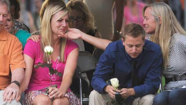 Women Who Survived Theater Shooting Grieve for Hero Boyfriends