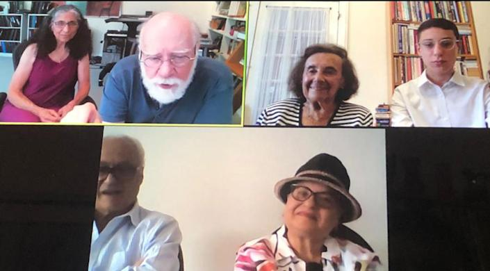 Image: Lilly Ebert and Dov Forman (right) hold a Zoom call with Arlene and Jason Schulman, descendants of the American GI that liberated Lilly during the war, along with Lilly's daughter and husband Bilha and Julian Weider. (Dov Forman)