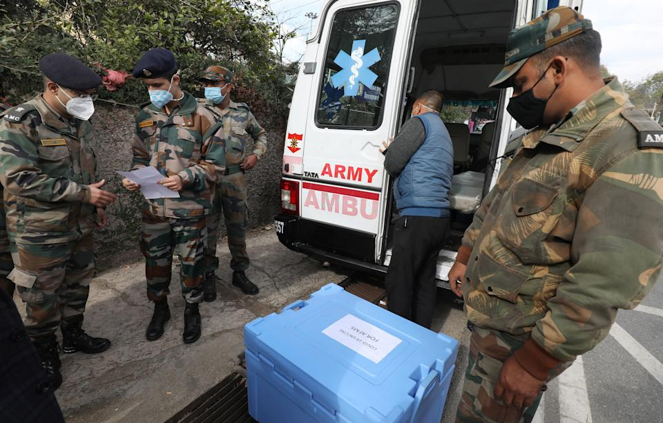 Indian army personnel assist in distributing the Covid-19 vaccines (EPA-EFE)