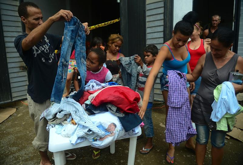 Cuban migrants choose clothes donated by locals in Colombia (AFP Photo/Raul Arboleda)