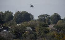 FILE PHOTO: An Azerbaijani military helicopter flies during the fighting over the breakaway region of Nagorno-Karabakh near the city of Terter