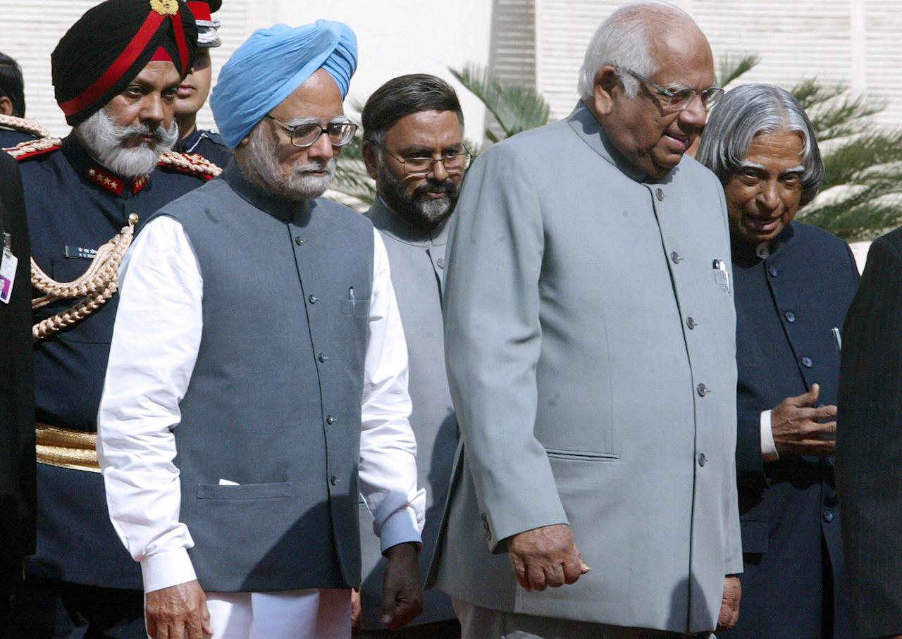 <p>Former Indian Prime Minister Manmohan Singh, former Speaker Somnath Chatterjee and former Indian President Abdul Kalam arrive at the Parliament on the opening day of the Budget Session, in New Delhi, 16 February 2006. (Photo by RAVEENDRAN/AFP/Getty Images) </p>