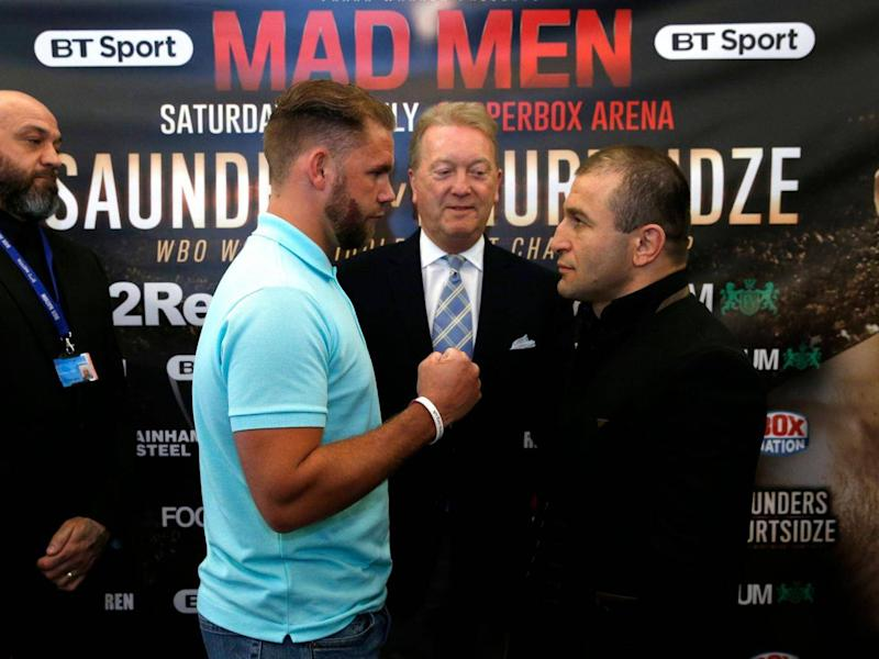 Avtandil Khurtsidze (right) faces British boxer Billy Joe Saunders at a press conference to promote their planned fight. Before it could take place, Khurtsidze was arrested. (Reuters / Andrew Couldridge )