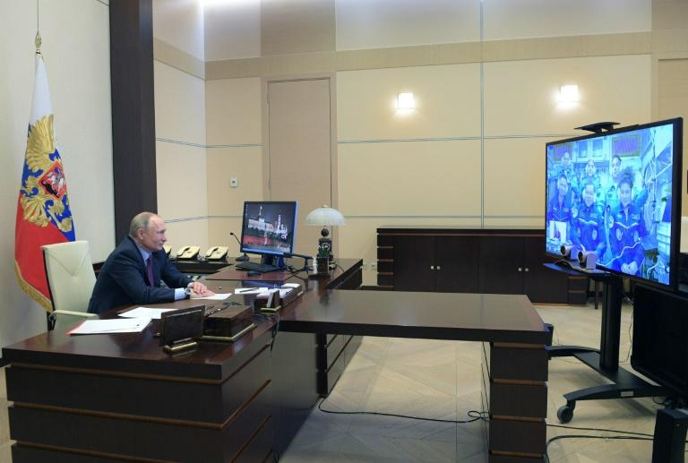Russian President Vladimir Putin holds a video link with cosmonauts onboard the International Space Station (AFP Photo/Alexey DRUZHININ)