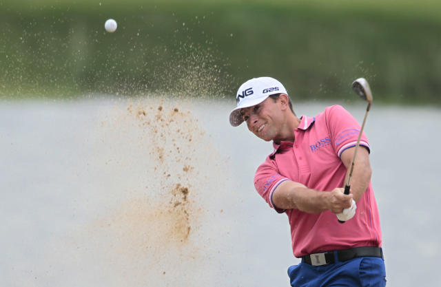 Luke Guthrie of the United States hits out of a bunker at 4th hole during the second round of the Masters golf tournament at the Lake Malaren Golf Club in Shanghai, China, Fridday, Oct. 25, 2013. (AP Photo)