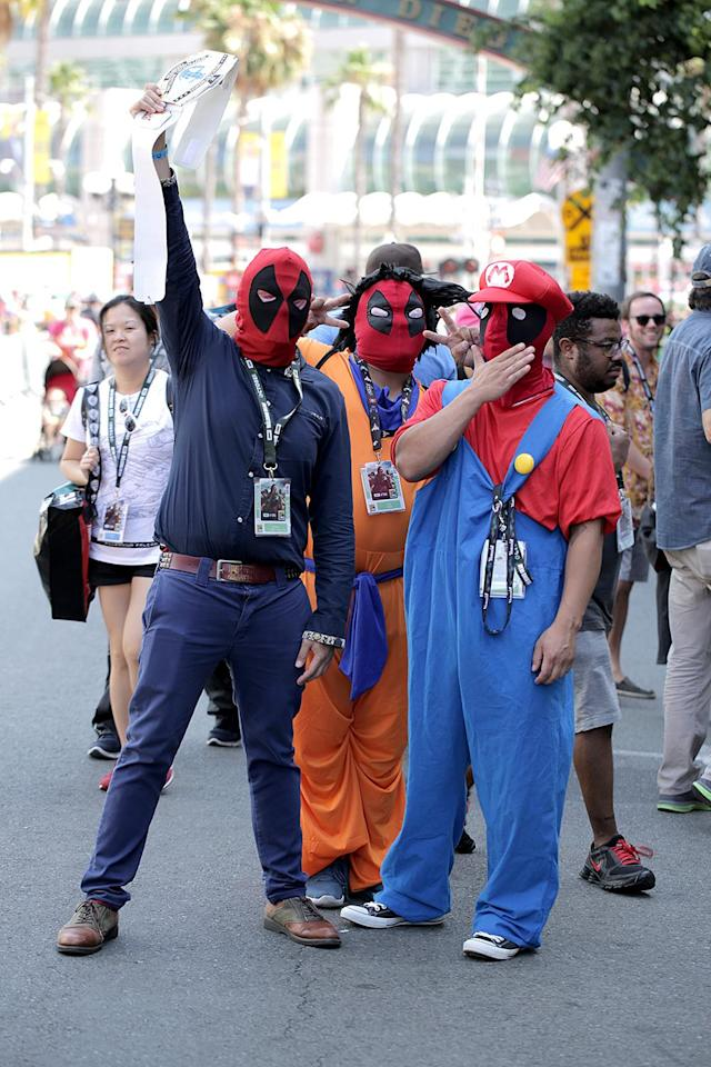 <p>Cosplayers wear Deadpool masks at Comic-Con International on July 19, 2018, in San Diego. (Photo: Quinn P. Smith/Getty Images) </p>