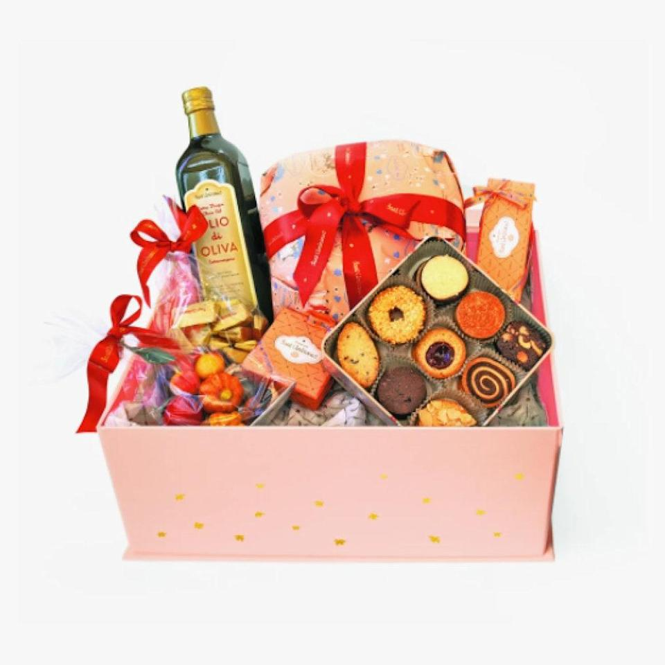"""Sant Ambroeus's holiday gift baskets (filled with Italian goodies) go fast. Order yours now! $245, Sant Ambroeus. <a href=""""https://sant-ambroeus.myshopify.com/collections/frontpage/products/gift-box"""" rel=""""nofollow noopener"""" target=""""_blank"""" data-ylk=""""slk:Get it now!"""" class=""""link rapid-noclick-resp"""">Get it now!</a>"""