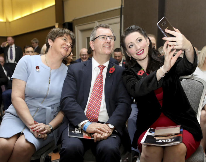 FILE - In this file photo dated Saturday, Oct. 26, 2019, Northern Irish lawmakers, from left, Democratic Unionist Party leader Arlene Foster, with party members Jeffrey Donaldson and Emma Littele-Pengelly, at the party's annual conference in Belfast, Northern Ireland. Northern Ireland's largest British unionist party is choosing a new leader Friday May 14, 2021, in a contest between Northern Ireland Agriculture Minister Edwin Poots and lawmaker Jeffrey Donaldson, with only 36 eligible voters and the result due late Friday afternoon. (AP Photo/Peter Morrison, FILE)