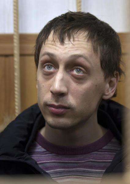 Bolshoi soloist Pavel Dmitrichenko listens in a courtroom in Moscow, Russia, Thursday, March 7, 2013. The 29-year-old soloist admits to organizing the attack, but tells a Moscow court Thursday that he never intended for it to cause such harm to Filin. In his most famous roles the dancer plays villainous or violent men, and his new real-life role adds a creepiness factor to the photographs of him leaping across the stage with a dagger or sword in hand. Dmitrichenko says he was angry at Filin for what he describes as corruption and favoritism at the theater, while reports have played up his relationship with a young ballerina who feels she has been unfairly passed over for starring roles. (AP Photo/Alexander Zemlianichenko)