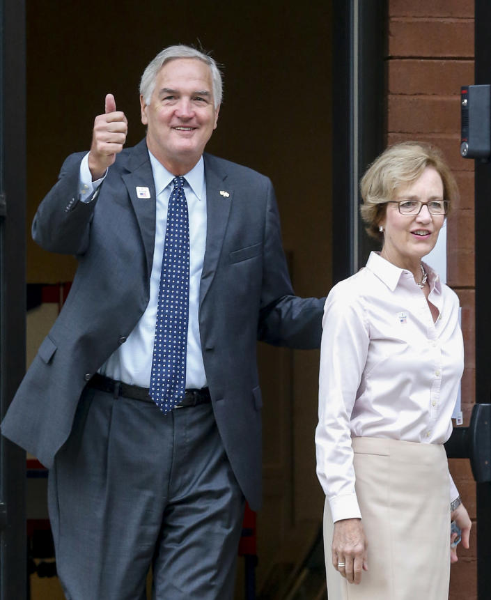 Senator Luther Strange after voting with his wife, Melissa, Tuesday, Aug. 15, 2017, in Homewood, Ala. (Photo: Butch Dill/AP)