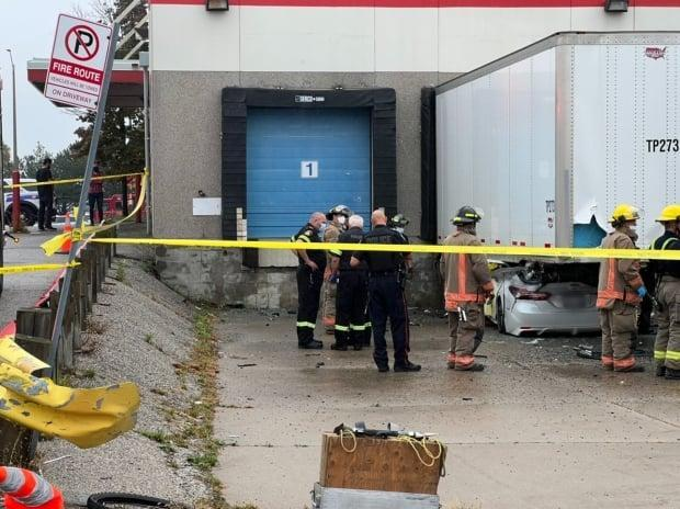 The driver died at the scene after crashing into a parked trailer in a private parking lot in Mississauga on Oct. 4, 2021.  (Submitted by Jeremy Cohn - image credit)